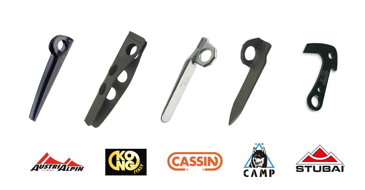 Das Bild zeigt eine Reihe an Felshaken in der Oberen Reihe. In der unteren Reihe die entsprechenden Logos der Hersteller Austrialpin, Kong, Cassin, Camp und Stubai.