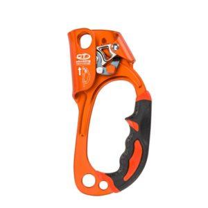 Das Bild zeigt die Climbing Technology Quick Up Steigklemme für die rechte Hand von der Innenseite. Man sieht in Bildmitte den orangen Jümar mit dem Klemmechanismus oben und dem Gummigriff rechts unten.