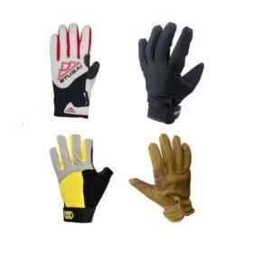Das Bild zeigt vier verschiedene Kletterhandschuhe. Vonlinks oben im Uhrzeigersinn: einen weiß-roten Stubai Klettersteig-Handschuh, einen schwarzen isolierten Kletterhandschuh, einen Leder Handschu und links unten einen schwarz-gelben Klettersteighandschuh der Firma Kong.