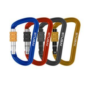 Das Bild zeigt vier Materialkarabiner Stubai Accessory Minikarabiner Zubehörkarabiner. Von links nach rechts die Farben Blau, Rot, Schwarz und Golden.