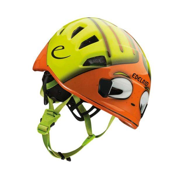 Das Bild zeigt den Edelrid Kinderhelm Kid´s Shield. Der Kinderhelm liegt schräg im Bild, hat gelbe und orange Farben und sieht wie ein Frosch aus. Er hat grüne Kinnriemen.
